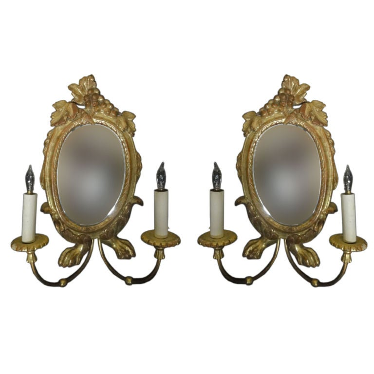 A Pair of Gilt Wood Sconce with Mirrors and Lion's Paw Feet at 1stdibs