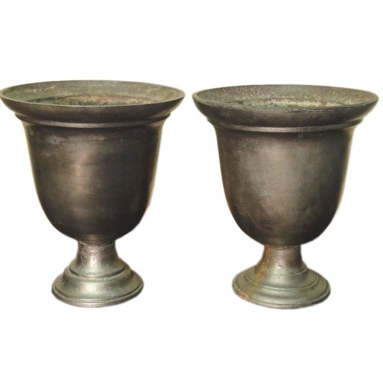 A Near Pair Of Unusual Bell Shaped 19th C Cast Iron