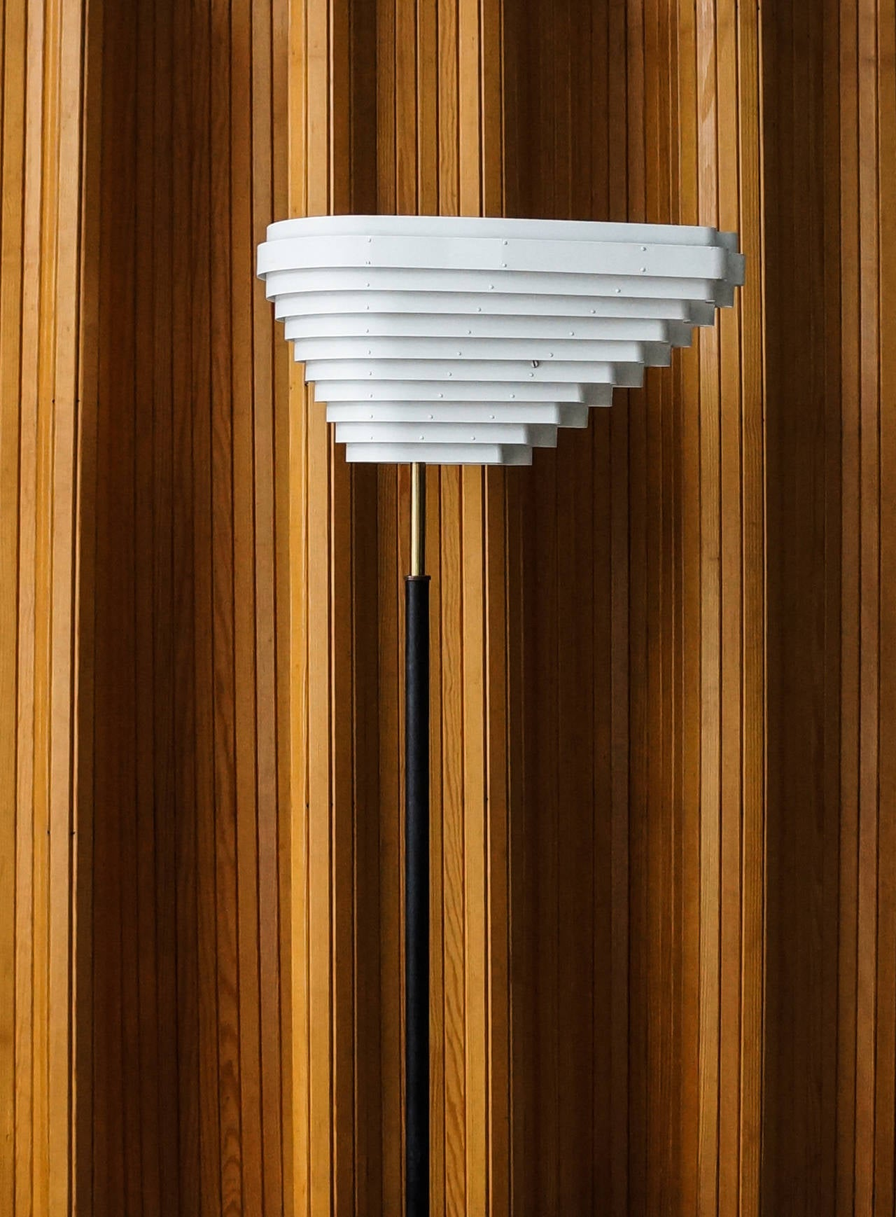Alvar Aalto Floor lamp A805.  Valaistustyö Ky. Finland, 1954  White painted metal, brass, tubular brass and black leather-wrapped metal. Stem impressed with Valaistustyö A 805. Measures: Height, circa 172 cm, width, circa 50 cm.  A805, also known