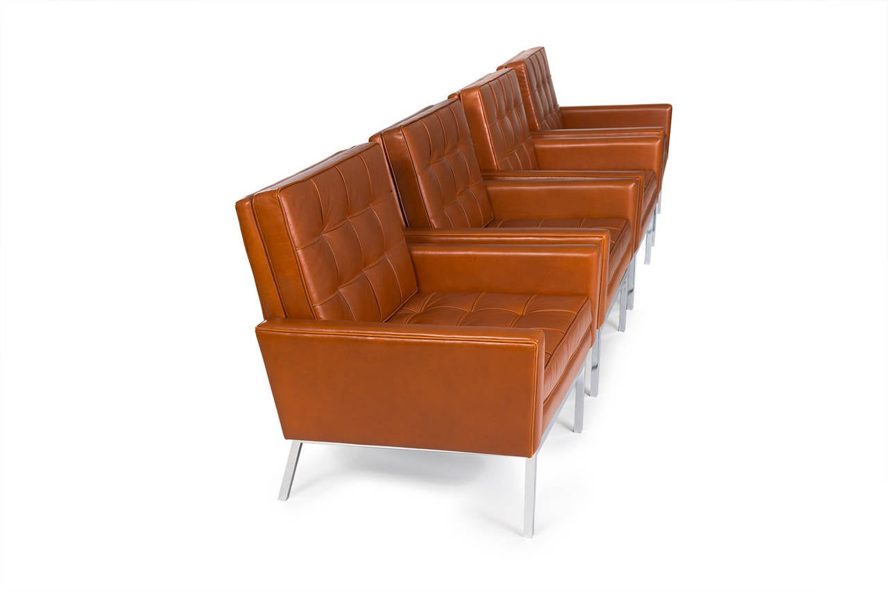 Florence Knoll.  Armchair, model #65A (set of four).  Knoll, USA, circa 1965. Leather, matte chrome-plated steel. Measures: 34 W x 32 D x 31 H inches.  Literature: Knoll Furniture: 1938-1960, Rouland, pg. 95.