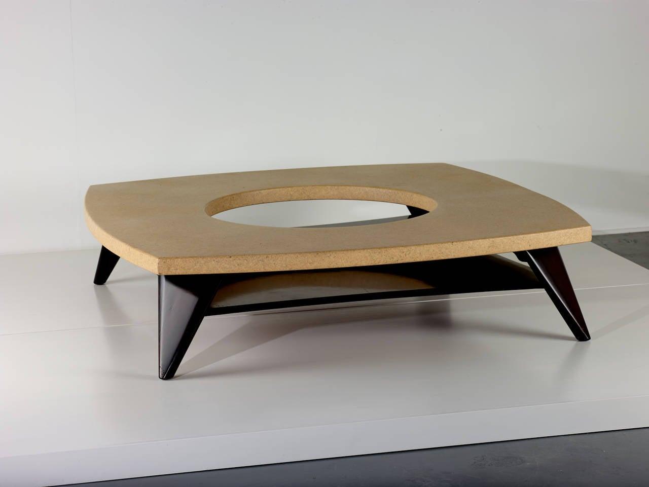 Paul Frankl.  Coffee table.  Johnson Furniture Company, USA, circa 1951. Lacquered cork, lacquered mahogany. Dimensions: 60 D x 14.25 H inches.  Rare lacquered cork coffee table by Paul Frankl.