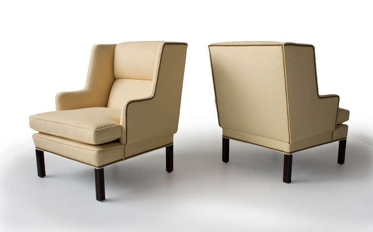 Pair of Edward Wormley for Dunbar lounge chairs with a nailhead trim.  Dunbar, USA, 1950s  upholstery, mahogany, bronze. Measures: 28 W x 28 D x 36 H inches.