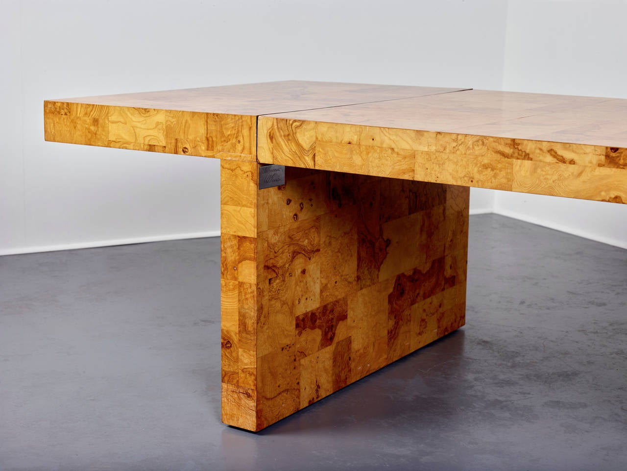 """Paul Evans.  Dining table,  USA, 1970s. Olive ash burl. Signed with brass plaque. Dimensions: 29 1/2"""" x 96"""" x 44"""", expands with two leaves: 22"""", 44""""."""