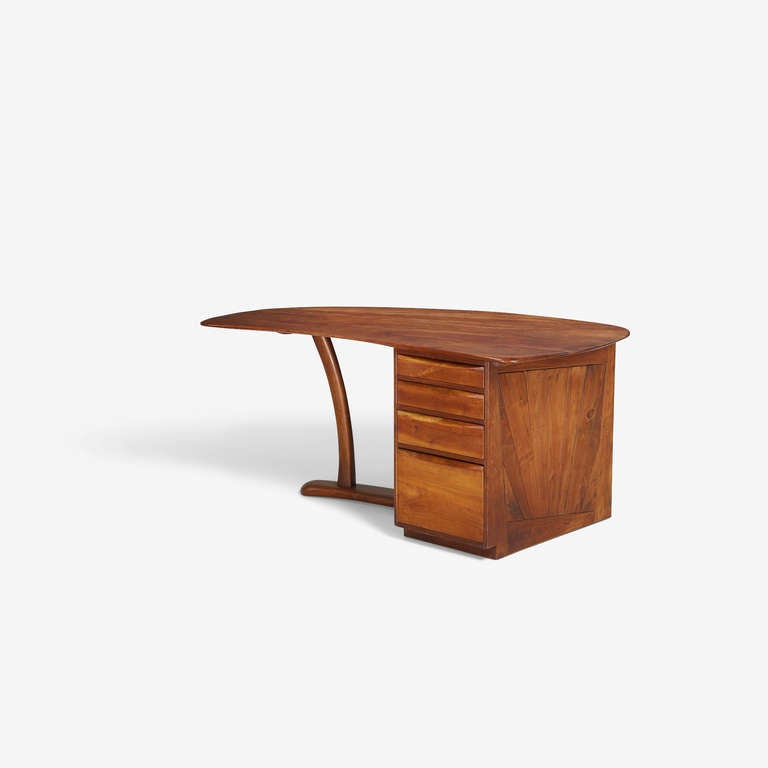 Wharton Esherick  single pedestal desk,  Paoli, PA, 1970. Walnut and cherry. Measures: 65 W x 37 D x 29.5 H inches.  Commissioned from artist from an important estate. Provenance provided upon request.