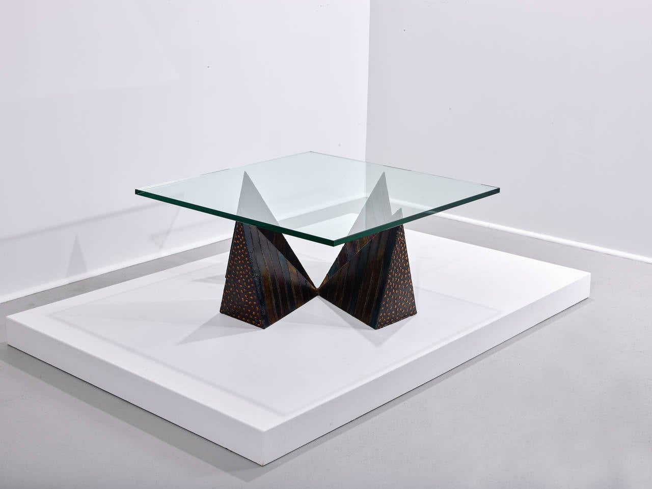 Paul Evans Coffee Table with Welded Pyramid Base  Paul Evans Studio for Directional Model PE 14-42 documented model USA circa 1973  All original and unrestored welded and enameled steel, bronze and glass.  High colored and deep weldings  Welded