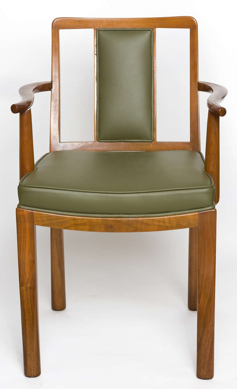 Edward Wormley, two armchairs and four side chairs.   Dunbar, USA.   Mahogany and leather.  Signed with applied gold rectangular metal manufacturer's label to seat bottom  [Dunbar Berne INDIANA].