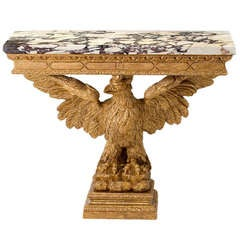 A George II giltwood marble-topped console table.