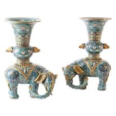 A pair of Chinese cloisonne enamel elephants.