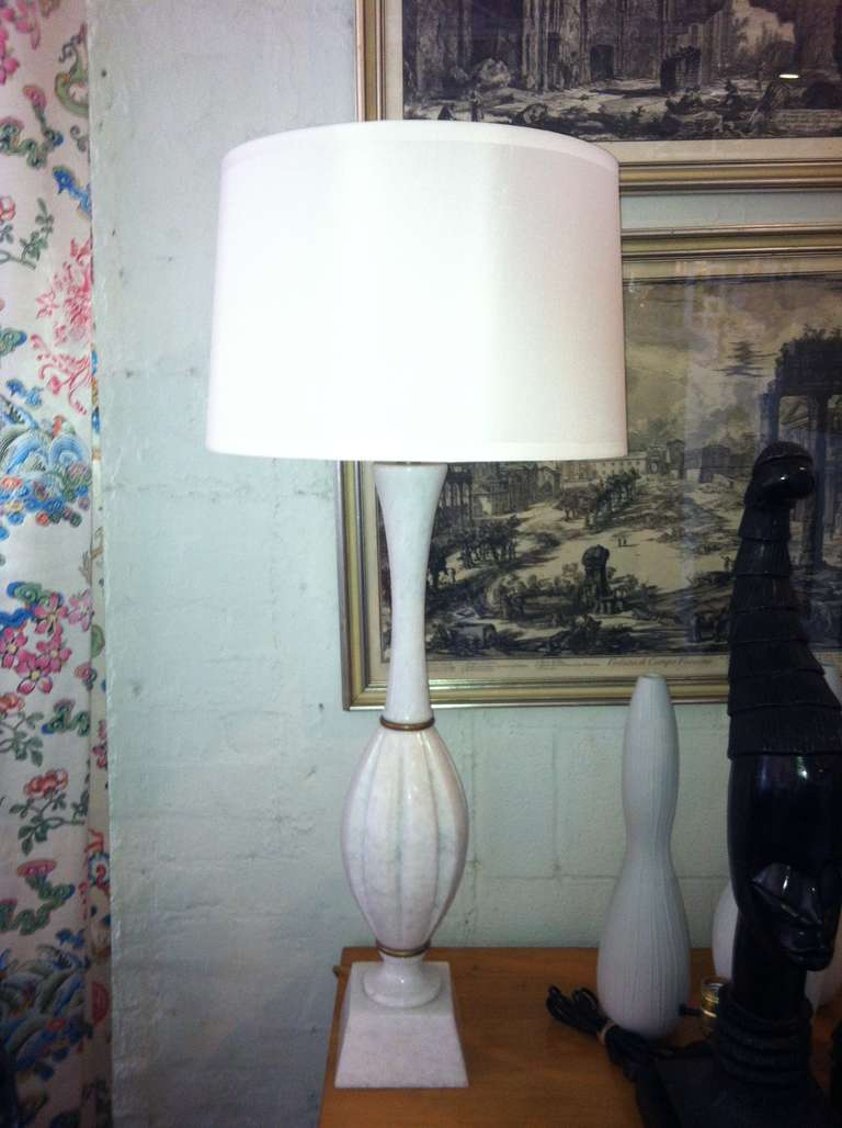 Beautiful pair of white marble lamps with silk shades and gold brass accents.