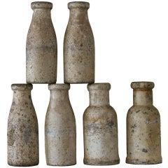 Collection of Six Carnival Knockdown Bottles