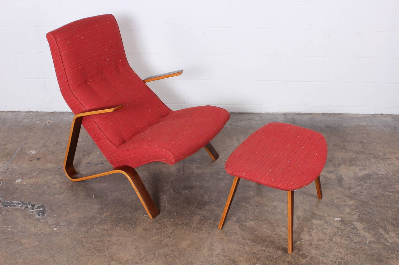 An iconic grasshopper lounge chair and matching ottoman designed by Eero Saarinen for Knoll.