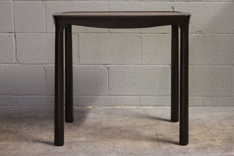 A large scale dark mahogany side table with rosewood top. Designed by Edward Wormley for Dunbar.