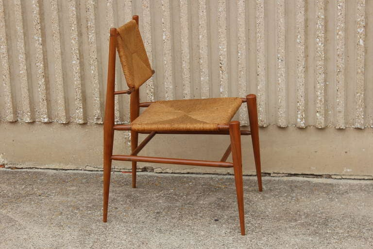 A beautifully made chair with exposed dowels and woven rush seat/back.
