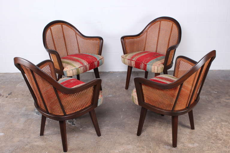 A set of four mahogany and cane chairs designed by Harvey Probber. A matching fifth chair is also available.