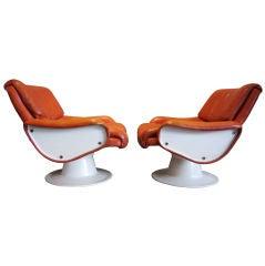 Pair of leather lounge chairs by Yrjö Kukkapuro