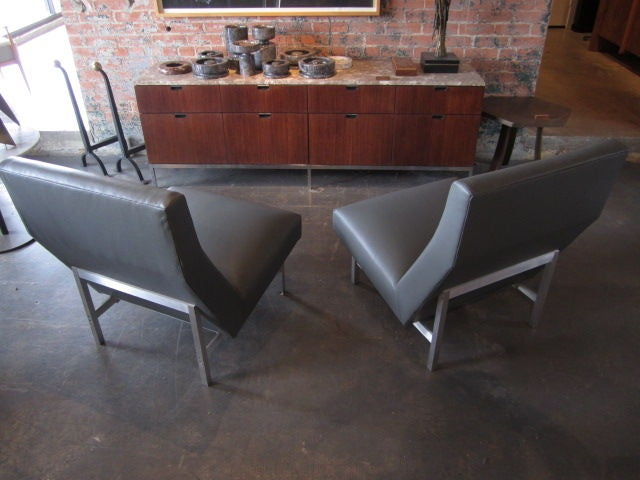 this pair of leather lounge chairs by jens risom is no longer