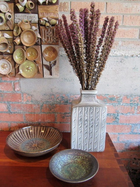Three pieces of studio pottery by Harding Black. <br /> 1. Small bowl (8.25 x 2.25) $700.<br /> 2. Large bowl (11.75 x 2.5) $1100.<br /> 3. Vase (7 x 5 x 13)  $1300.