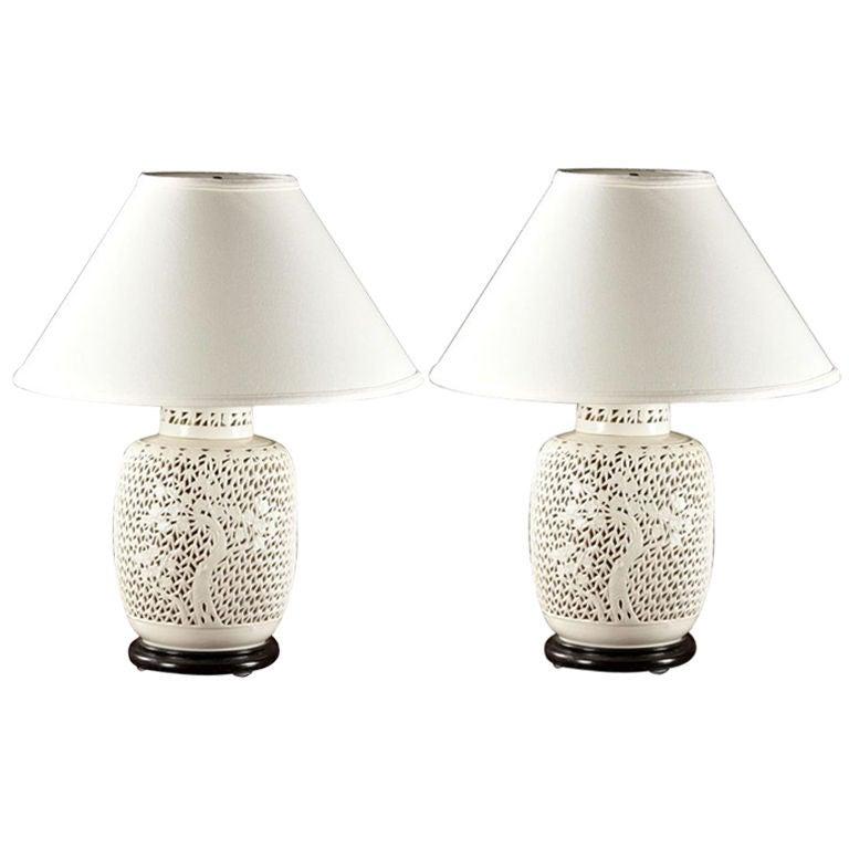 A Pair Of Pierced Porcelain Blanc De Chine Lamps Lit