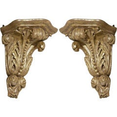 An Unusual Pair of English George II Giltwood Corner Brackets