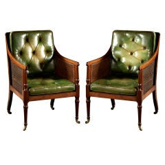 A Pair of English Mahogany Caned Bergeres