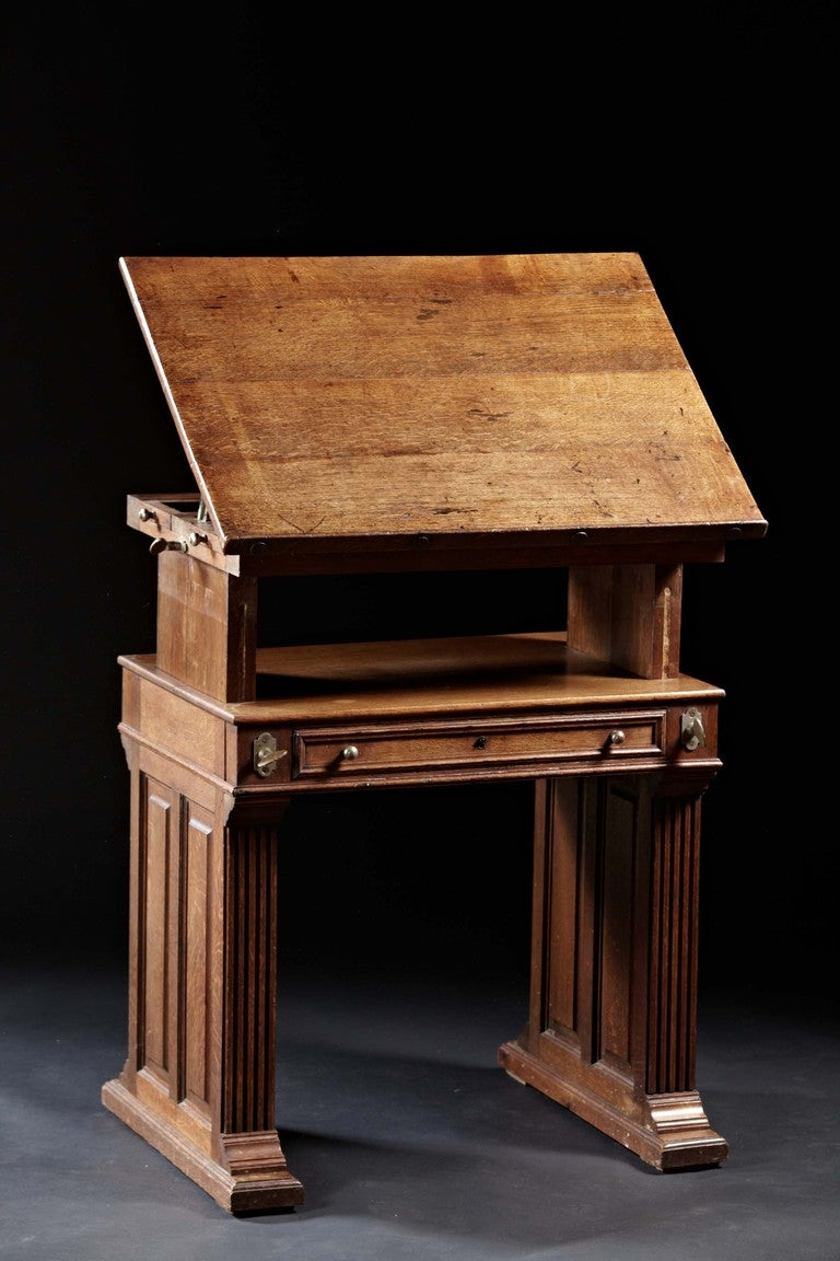 An Arts And Crafts Period Oak Drafting Table With