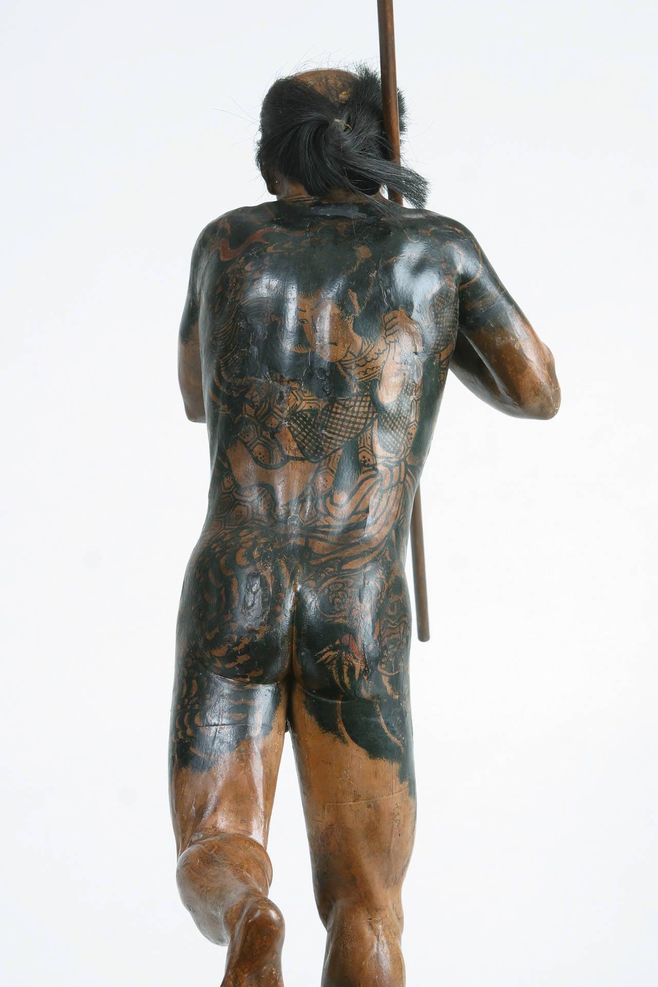 Tattooed Sculpture of a Japanese Running Man 2