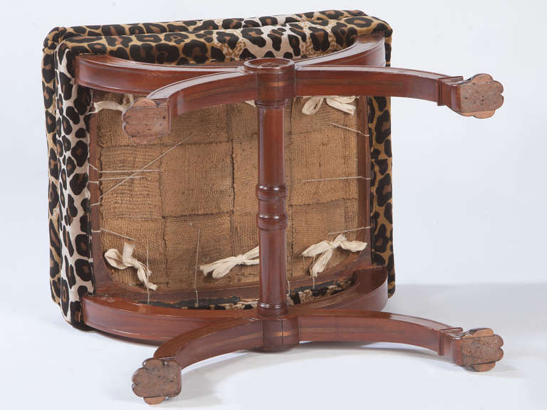 Fine pair of French mahogany curole form stools with animal paw feet.