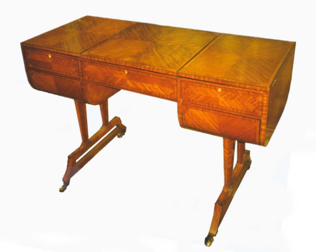 Unusual writing / dressing table by Waring & Gillow, featuring an intricate interior with fold out sides revealing fitted interiors, the mirror fitted center part opens to a leather writing surface which again covers a lower compartment underneath.
