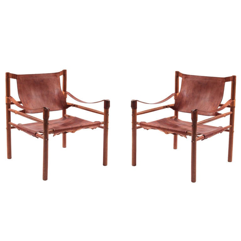 Pair Of Arne Norell Leather And Beechwood Safari Chairs At