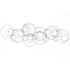 Inverted Circles Chrome Wall Sculpture
