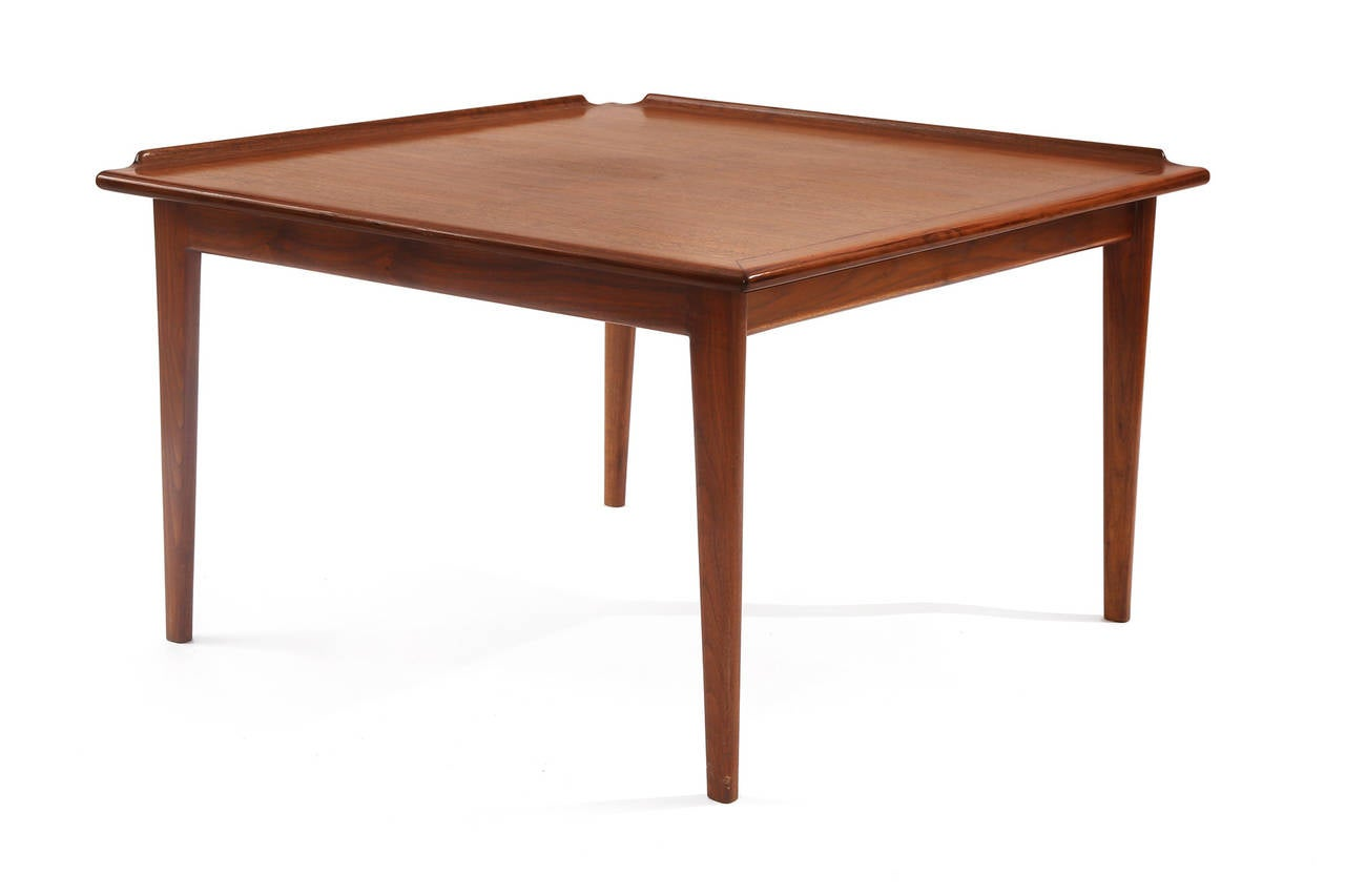Finn Juhl for Baker furniture oiled teak occasional or side table, circa mid-1960s. This all original example has linear subtly tapered legs elevated sides to the top and beautiful graining. Some slight wear to the center of the table.