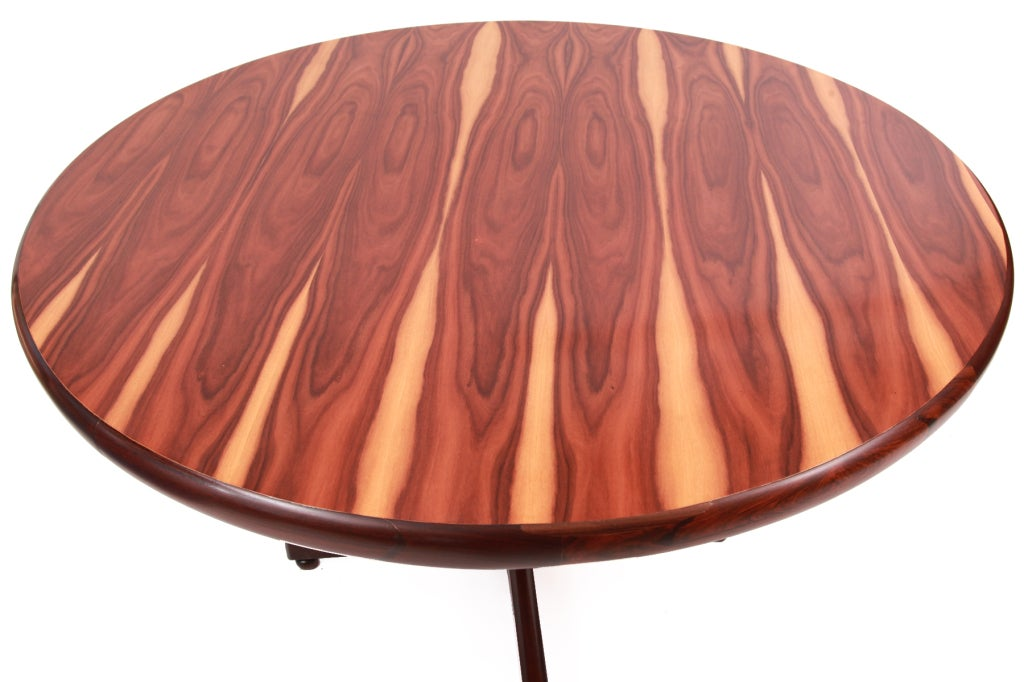 Beautiful Brazilian rosewood dining table by Sergio Rodrigues, circa late 1950s. This example has large and stunning sap grain on the table top and a solid rosewood base. Tabletop thickness is 2.5