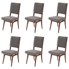Six Sculpted Walnut and Upholstered Dining Chairs