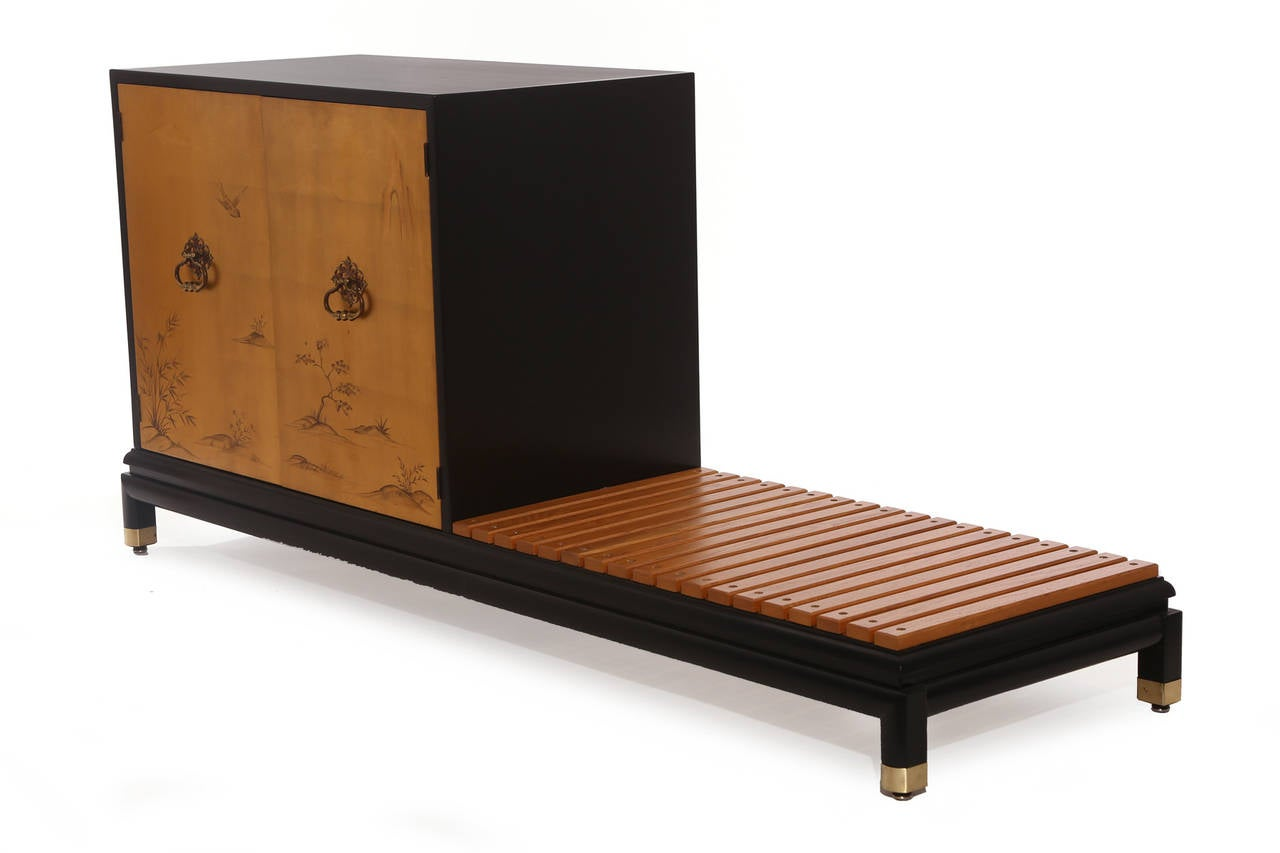 Renzo Rutili for Johnson Furniture Company chest with bench, circa late 1950s. This lovely example has gold leafed doors and ebonized case and bench. The interior of the chest has an adjustable shelf and the case is finished on the front and back.