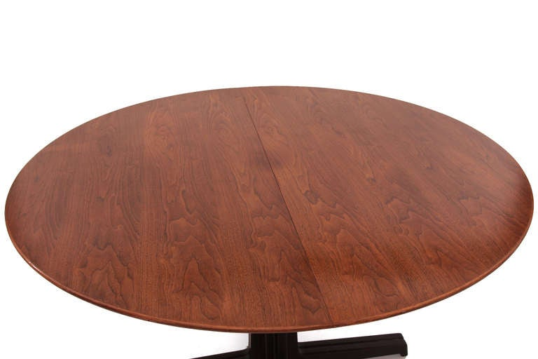 Sculptural Edward Wormley for Dunbar walnut dining table circa late 1950s. This example has a beautifully grained walnut top and stunning solid walnut base. This table can accommodate two leaves but currently does not have any. We are happy to make