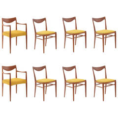 Eight Rastad & Relling Sculpted Teak Dining Chairs