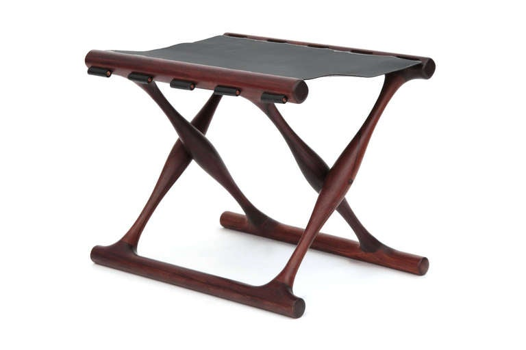 Rare Poul Hundevad rosewood and leather folding stool, circa late 1950s. This example is solid rosewood and has been newly upholstered in black saddle leather.