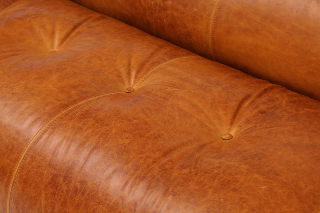 """Rare """"Anfibio"""" sofa designed by Alessandro Becchi for Giovannetti circa early 1970's. This extraordinary convertible sofa has been impeccably restored in a wonderfully patinated caramel leather and easily converts to a double bed. The interior has"""