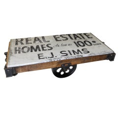Vintage Cart With Real Estate Logo