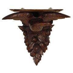 Carved eagle wall bracket