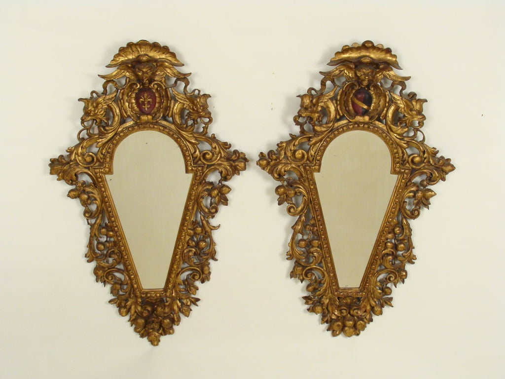 Pair of Italian Baroque style giltwood mirrors, late 19th century.