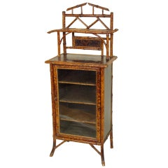 chinoserie decorated bamboo cabinet