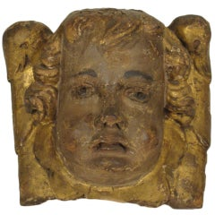 18th century cupid face carving