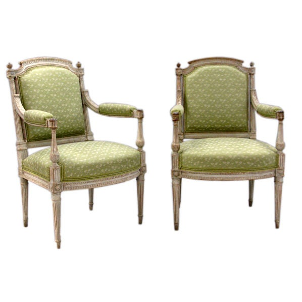 A pair of painted beech wood Louis XVI armchairs (Fauteuils)