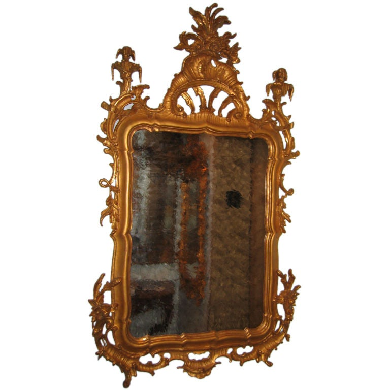 Pair of carved and gilded rococo mirrors at 1stdibs for Gilded baroque mirror