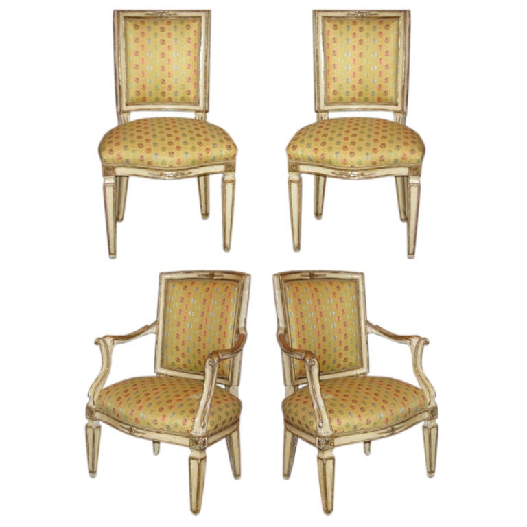 A Set Four Neapolitan Painted And Mecca Gilded Chairs