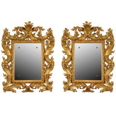 A Fine Pair of Carved and Gilded Mirrors