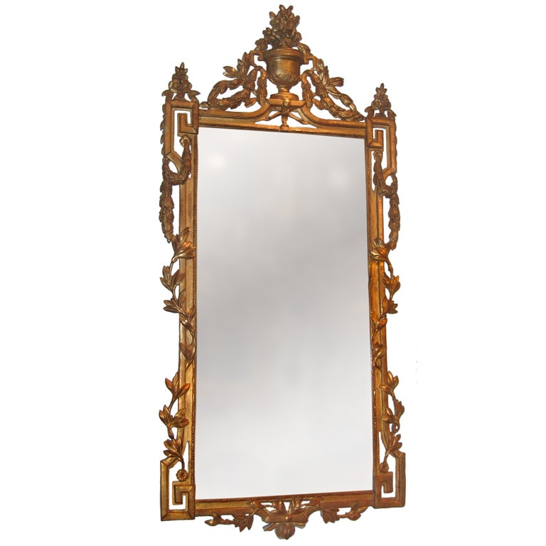 A Louis XVI painted and gilded wood mirror with Greek key