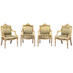 Extremely Rare Set of Four George III Carved Giltwood Armchairs