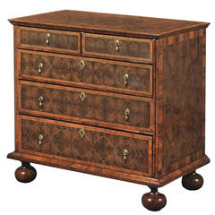 A William And Mary Walnut And Olivewood Oyster-veneered Chest Of Drawers
